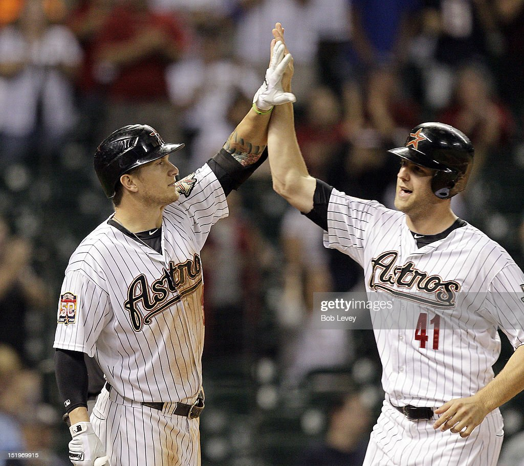 <a gi-track='captionPersonalityLinkClicked' href=/galleries/search?phrase=Jordan+Lyles&family=editorial&specificpeople=7520081 ng-click='$event.stopPropagation()'>Jordan Lyles</a> #41 of the Houston Astros high-fives Brandon Barnes #39 after scoring in the eighth inning against the Philadelphia Phillies at Minute Maid Park on September 13, 2012 in Houston, Texas. Houston wins 6-4.