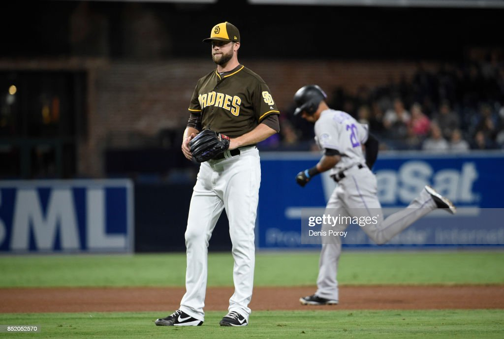 Jordan Lyles #27 of the San Diego Padres looks to the infield after giving up a solo home run to Ian Desmond #20 of the Colorado Rockies during the fifth inning of a baseball game at PETCO Park on September 22, 2017 in San Diego, California.