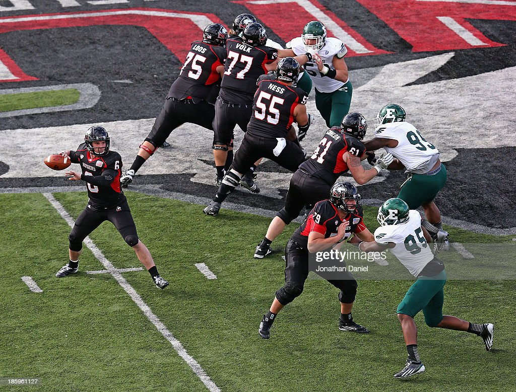 Jordan Lynch #6 of the Northern Illinois Huskies drops back to pass under the protection of his offensive line against the Eastern Michigan Eagles at Brigham Field on October 26, 2013 in DeKalb, Illinois.