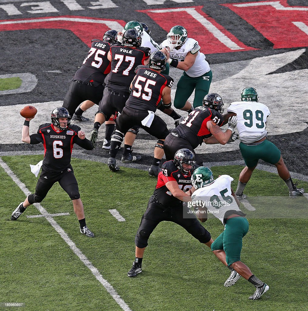 Jordan Lynch #6 of the Northern Illinois Huskies drops back to pass under the protection of his offensive line against the Eastern Michigan Eagles at Brigham Field on October 26, 2013 in DeKalb, Illinois. Northern Illinois defeated Eastern Michigan 59-20.