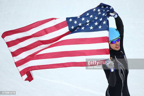 Jordan Malone of the United States celebrates winning the silver medal in the Short Track Men's 5000m Relay on day fourteen of the 2014 Sochi Winter...