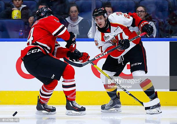 Jordan Martel of the Baie Comeau Drakkar passes the puck against the Quebec Remparts during their QMJHL hockey game at the Centre Videotron on...
