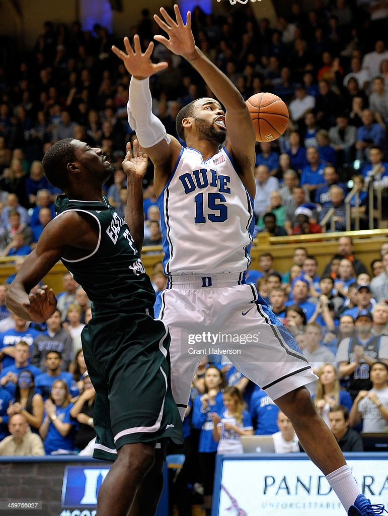 Jordan Martin #22 of the Eastern Michigan Eagles fouls Josh Hairston #15 of the Duke Blue Devils during their game at Cameron Indoor Stadium on December 28, 2013 in Durham, North Carolina. Duke won 82-59.