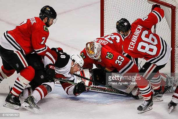 Jordan Martinook of the Arizona Coyotes attempts to get the puck past goalie Scott Darling of the Chicago Blackhawks in the third period of the NHL...