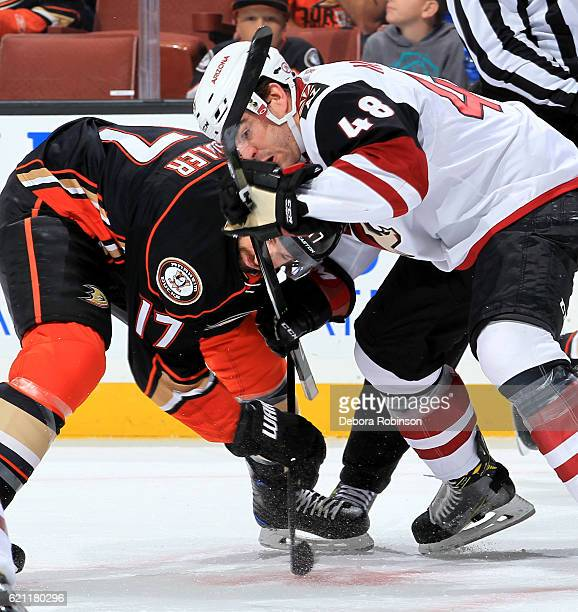 Jordan Martinook of the Arizona Coyotes battles in a faceoff against Ryan Kesler of the Anaheim Ducks on November 4 2016 at Honda Center in Anaheim...