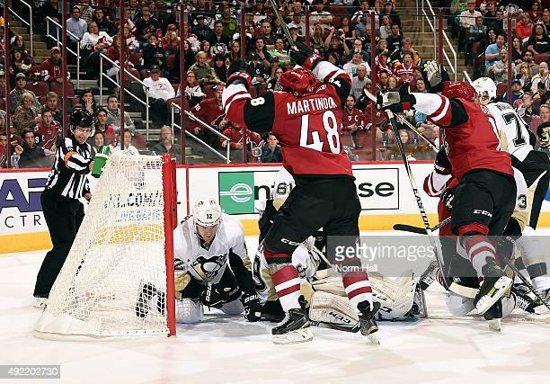 Jordan Martinook of the Arizona Coyotes celebrates his second period goal against the Pittsburgh Penguins at Gila River Arena on October 10 2015 in...