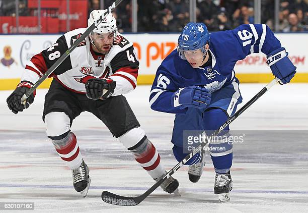 Jordan Martinook of the Arizona Coyotes chases after Mitchell Marner of the Toronto Maple Leafs during an NHL game at the Air Canada Centre on...