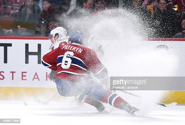 Jordan Martinook of the Arizona Coyotes controls the puck against Greg Pateryn of the Montreal Canadiens in the NHL game at the Bell Centre on...