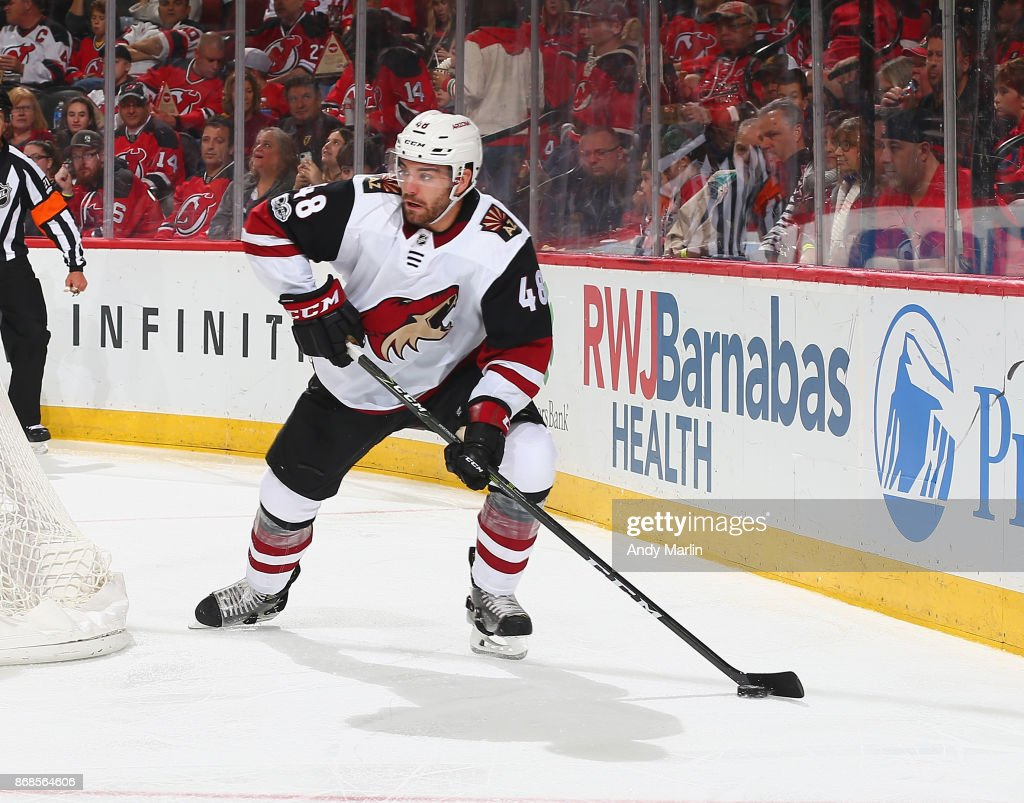 Jordan Martinook #48 of the Arizona Coyotes controls the puck against the New Jersey Devils during the game at Prudential Center on October 28, 2017 in Newark, New Jersey.