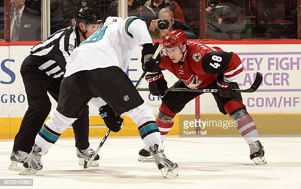 Jordan Martinook of the Arizona Coyotes gets ready to take a face off against Joe Thornton of the San Jose Sharks at Gila River Arena on November 1...