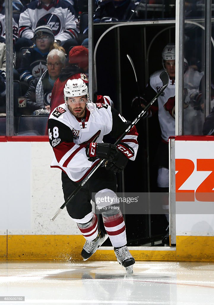 Jordan Martinook #48 of the Arizona Coyotes hits the ice prior to puck drop against the Winnipeg Jets at the MTS Centre on January 18, 2017 in Winnipeg, Manitoba, Canada.