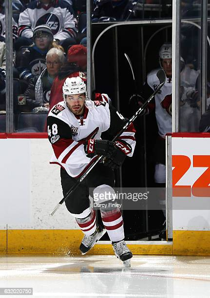 Jordan Martinook of the Arizona Coyotes hits the ice prior to puck drop against the Winnipeg Jets at the MTS Centre on January 18 2017 in Winnipeg...