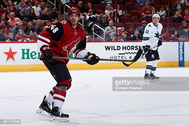 Jordan Martinook of the Arizona Coyotes in action during the NHL preseason game against the San Jose Sharks at Gila River Arena on October 2 2015 in...