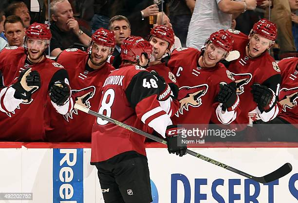Jordan Martinook of the Arizona Coyotes is congratulated by teammates after his second period goal against the Pittsburgh Penguins at Gila River...