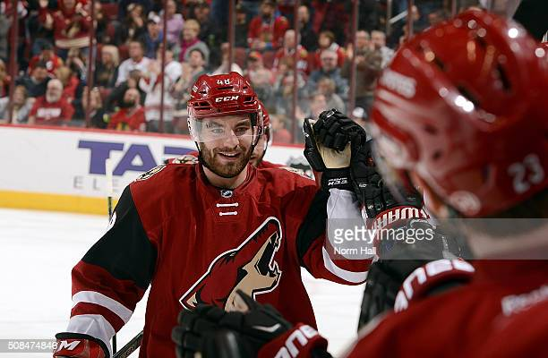Jordan Martinook of the Arizona Coyotes is congratulated by teammates after his second period goal against the Chicago Blackhawks at Gila River Arena...