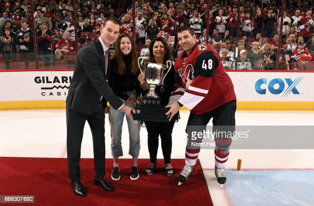 Jordan Martinook of the Arizona Coyotes is presented with the Jukka Nieminen Memorial Award for Hardest Working Player by general Manager John Chayka...