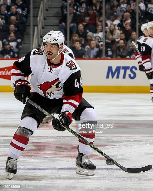 Jordan Martinook of the Arizona Coyotes plays the puck during first period action against the Winnipeg Jets at the MTS Centre on November 21 2015 in...