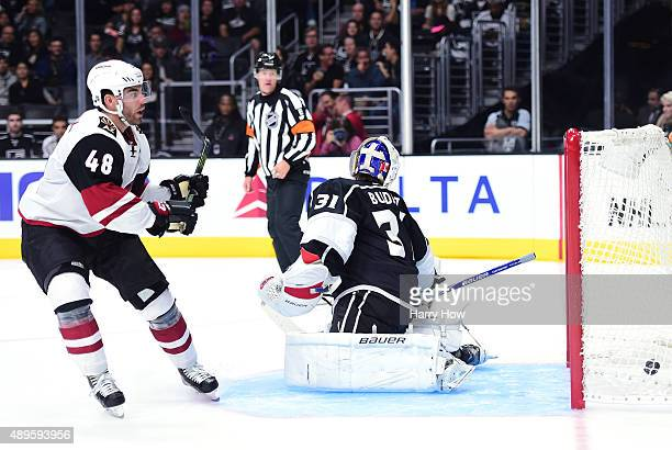 Jordan Martinook of the Arizona Coyotes scores a shorthanded goal on Peter Budaj of the Los Angeles Kings to tie the game 22 during the third period...