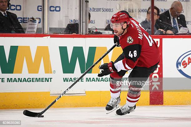 Jordan Martinook of the Arizona Coyotes skates with the puck during the first period of the NHL game against the Vancouver Canucks at Gila River...