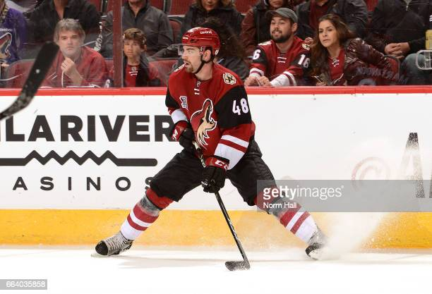 Jordan Martinook of the Arizona Coyotes stops along the boards with the puck against the Washington Capitals at Gila River Arena on March 31 2017 in...