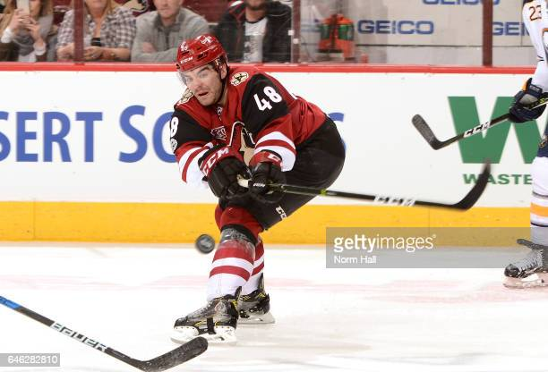 Jordan Martinook of the Arizona Coyotes swings his stick at the puck against the Buffalo Sabres at Gila River Arena on February 26 2017 in Glendale...
