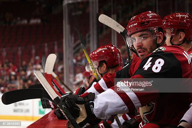 Jordan Martinook of the Arizona Coyotes watches from the bench during the preseason NHL game against San Jose Sharks at Gila River Arena on October 7...