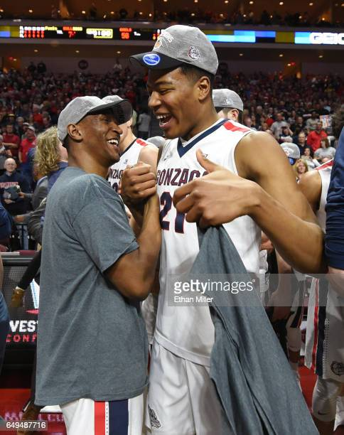 Jordan Mathews and Rui Hachimura of the Gonzaga Bulldogs celebrate on the court after defeating the Saint Mary's Gaels 7456 to win the championship...