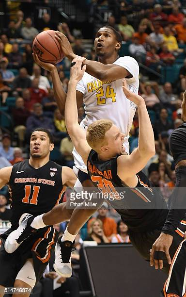 Jordan Mathews of the California Golden Bears is called for a charge against Olaf Schaftenaar of the Oregon State Beavers during a quarterfinal game...