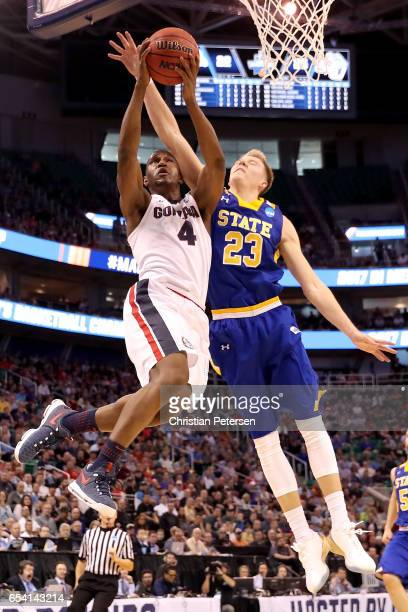 Jordan Mathews of the Gonzaga Bulldogs drives to the basket against Reed Tellinghuisen of the South Dakota State Jackrabbits in the first half during...