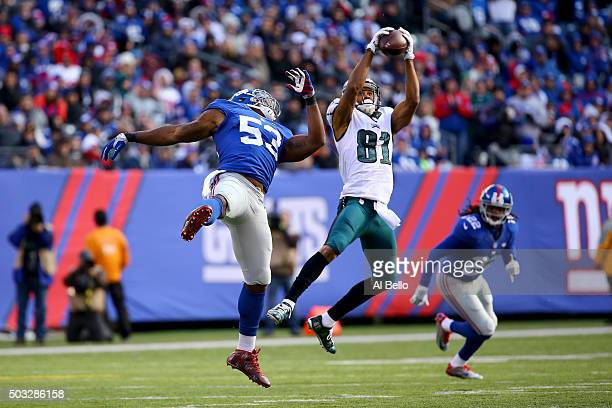 Jordan Matthews of the Philadelphia Eagles catches a pass in the first half against Jasper Brinkley of the New York Giants during their game at...