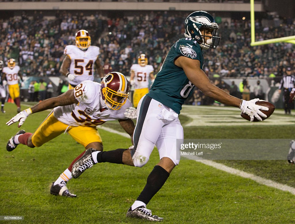 Jordan Matthews #81 of the Philadelphia Eagles runs past Dashon Goldson #38 of the Washington Redskins to score a touchdown in the fourth quarter on December 26, 2015 at Lincoln Financial Field in Philadelphia, Pennsylvania. The Redskins defeated the Eagles 38-24.