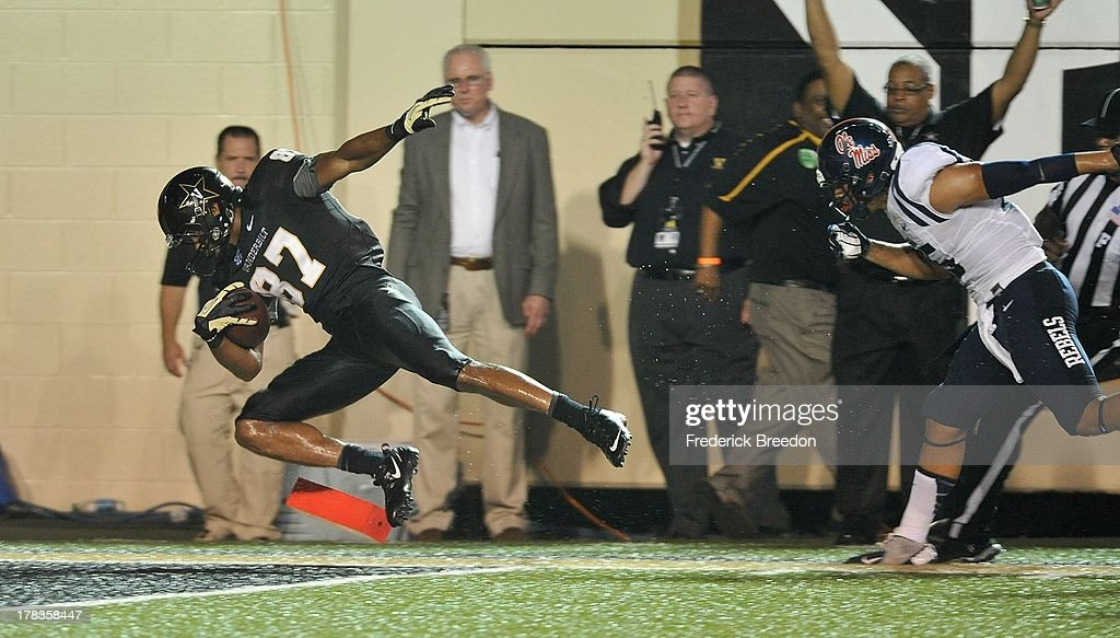 Jordan Matthews #87 of the Vanderbilt Commodores is pushed into the end zone for a touchdown against the Ole Miss Rebels at Vanderbilt Stadium on August 29, 2013 in Nashville, Tennessee.