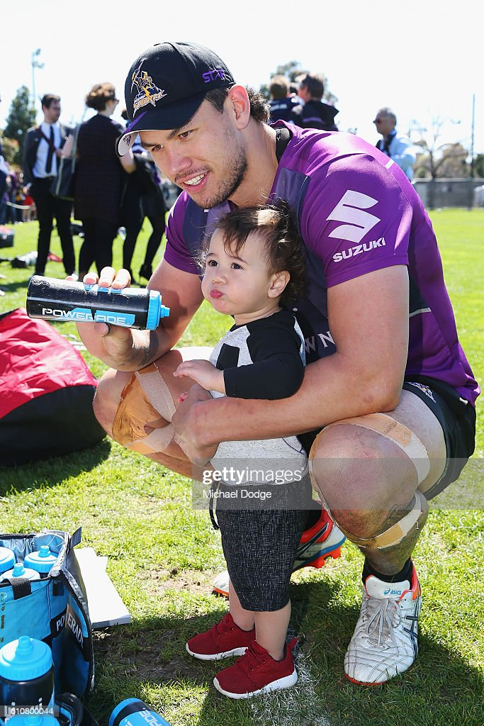 Jordan McLean of the Storm gives his son Archie a drink during a Melbourne Storm NRL training session at Gosch's Paddock on September 28, 2016 in Melbourne, Australia.
