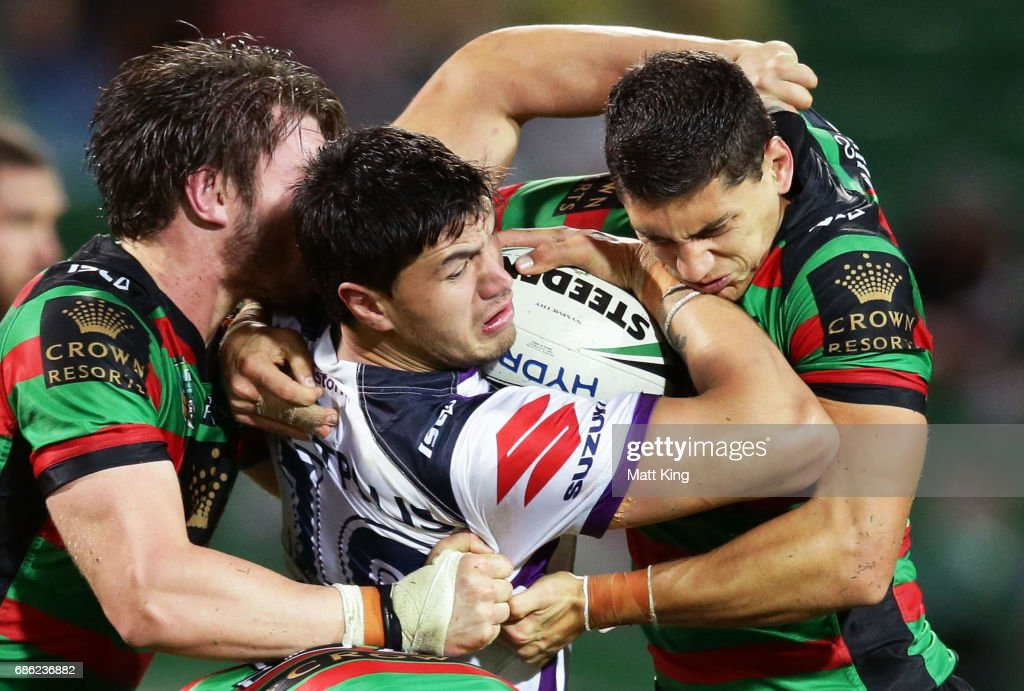 Jordan McLean of the Storm is tackled during the round 11 NRL match between the South Sydney Rabbitohs and the Melbourne Storm at nib Stadium on May 21, 2017 in Perth, Australia.