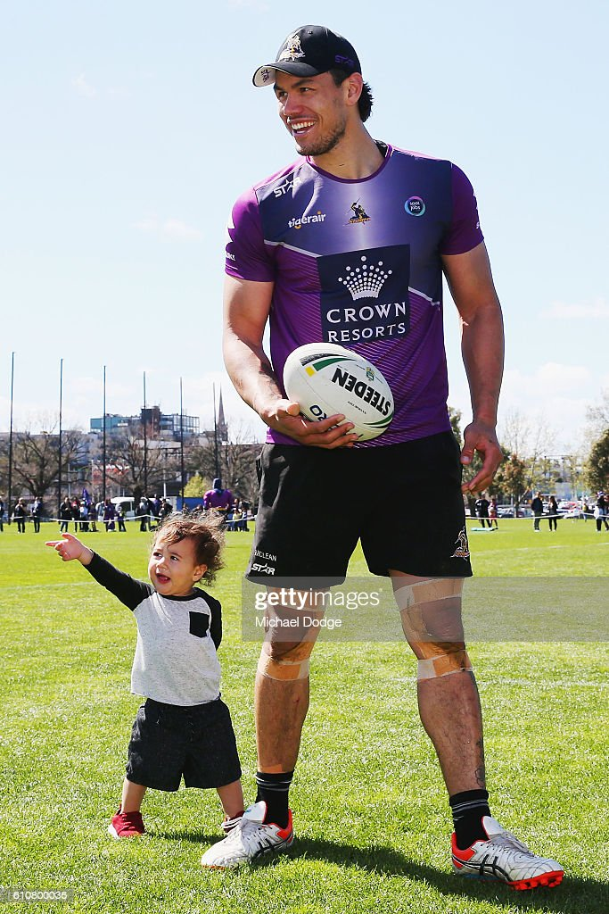 Jordan McLean of the Storm walks off with his son Archie during a Melbourne Storm NRL training session at Gosch's Paddock on September 28, 2016 in Melbourne, Australia.