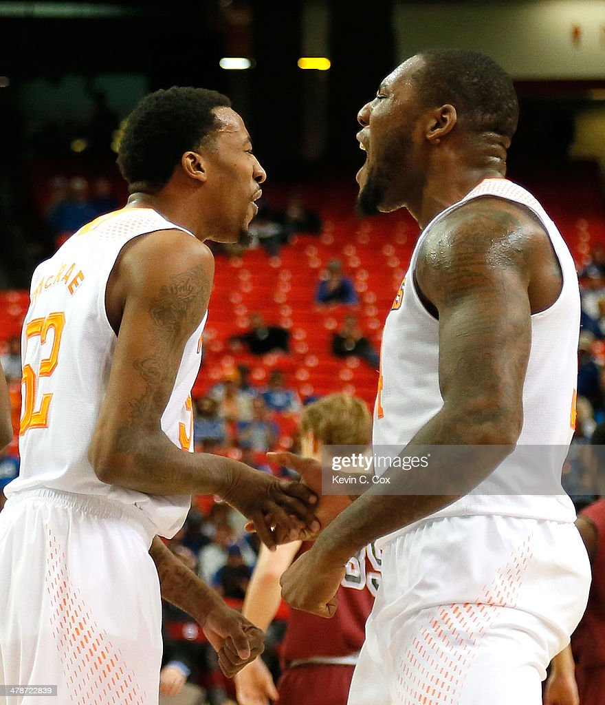 Jordan McRae #52 and Jeronne Maymon #34 of the Tennessee Volunteers react after a basket against the South Carolina Gamecocks during the quarterfinals of the SEC Men's Basketball Tournament at Georgia Dome on March 14, 2014 in Atlanta, Georgia.