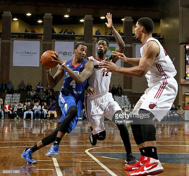 Jordan McRae from the Delaware 87ers drives against DeAndre Liggins and Jarnell Stokes from the Sioux Falls Skyforce at the Sanford Pentagon December...