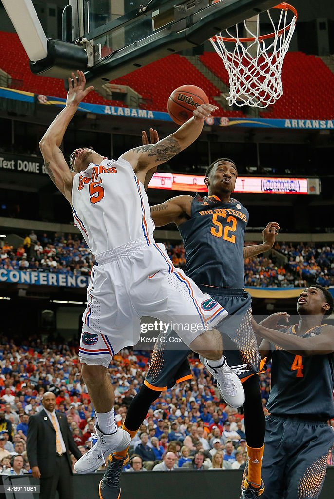 Jordan McRae of the Tennessee Volunteers blocks a shot by Scottie Wilbekin of the Florida Gators during the semifinals of the SEC Men's Basketball...
