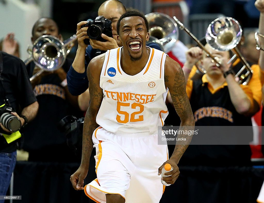 Jordan McRae #52 of the Tennessee Volunteers celebrates late in the game against the Mercer Bears during the third round of the 2014 NCAA Men's Basketball Tournament at PNC Arena on March 23, 2014 in Raleigh, North Carolina.