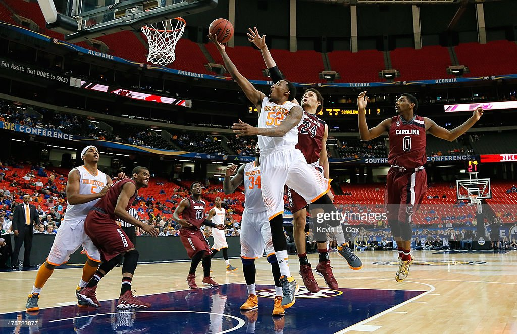 Jordan McRae #52 of the Tennessee Volunteers drives against Michael Carrera #24 of the South Carolina Gamecocks during the quarterfinals of the SEC Men's Basketball Tournament at Georgia Dome on March 14, 2014 in Atlanta, Georgia.