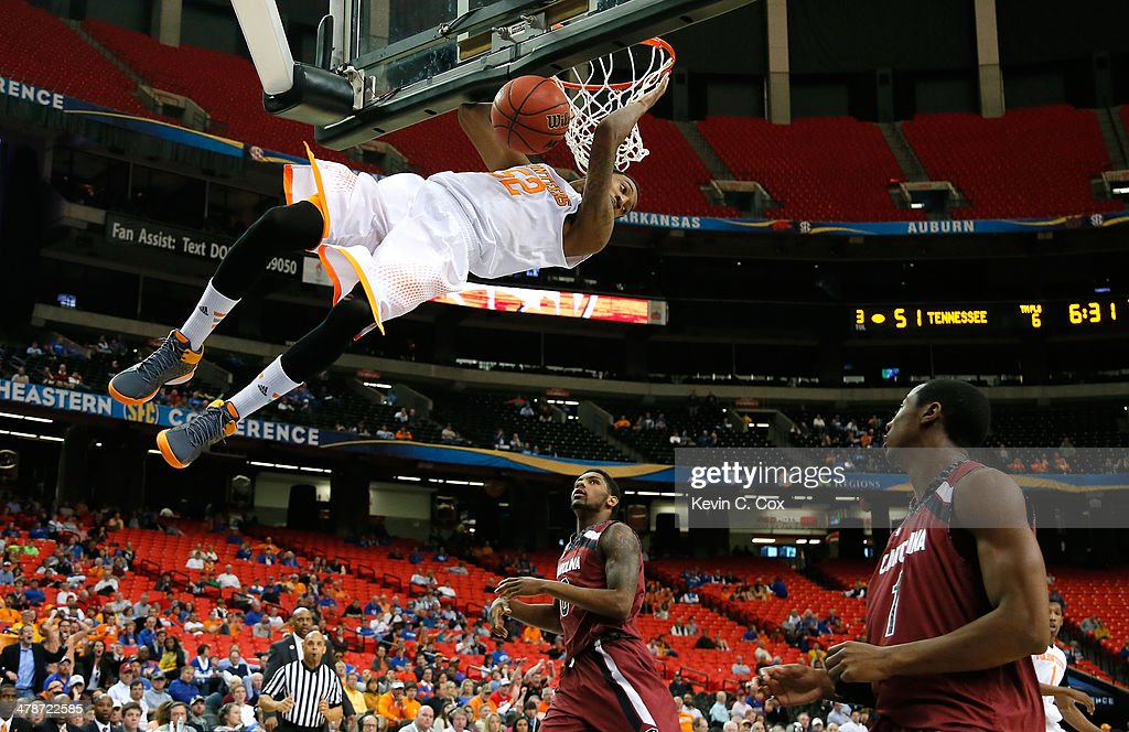 Jordan McRae #52 of the Tennessee Volunteers dunks against Sindarius Thornwell #0 and Brenton Williams #1 of the South Carolina Gamecocks against during the quarterfinals of the SEC Men's Basketball Tournament at Georgia Dome on March 14, 2014 in Atlanta, Georgia.