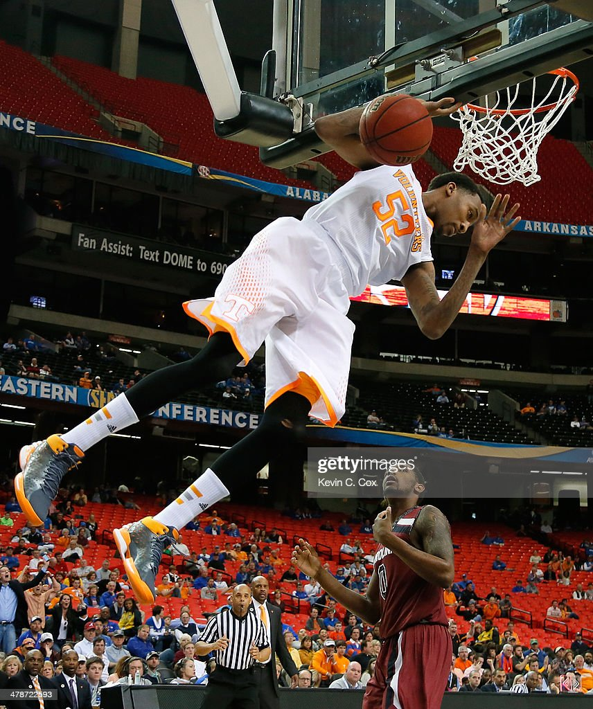 Jordan McRae #52 of the Tennessee Volunteers dunks against Sindarius Thornwell #0 of the South Carolina Gamecocks against during the quarterfinals of the SEC Men's Basketball Tournament at Georgia Dome on March 14, 2014 in Atlanta, Georgia.