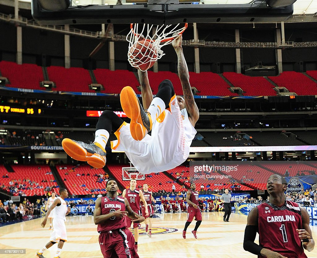 Jordan McRae #52 of the Tennessee Volunteers dunks against the South Carolina Gamecocks during the quarterfinals of the SEC Men's Basketball Tournament at the Georgia Dome on March 14, 2014 in Atlanta, Georgia. Photo by Scott Cunningham/Getty Images)