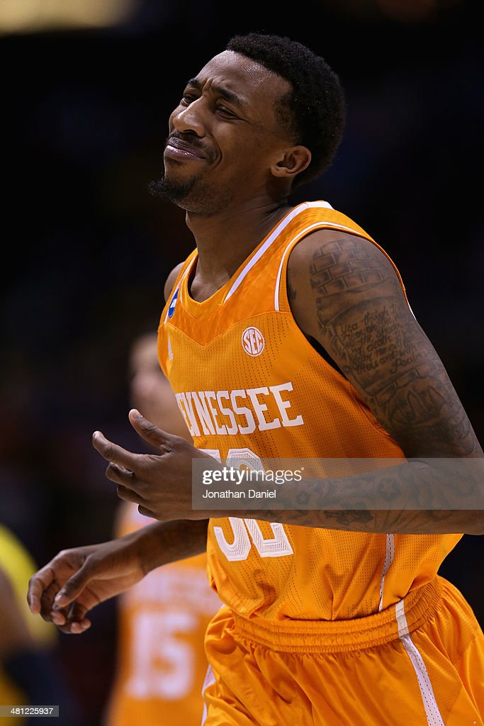 Jordan McRae of the Tennessee Volunteers reacts after missing the final shot to be defeated by the Michigan Wolverines 73 to 71 during the regional...