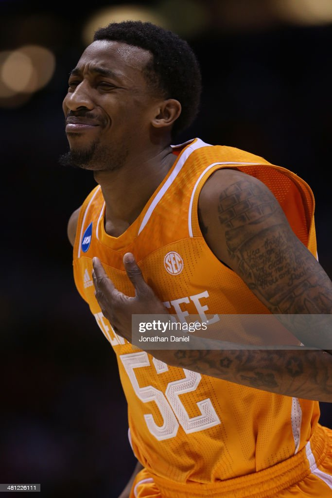 <a gi-track='captionPersonalityLinkClicked' href=/galleries/search?phrase=Jordan+McRae&family=editorial&specificpeople=7362664 ng-click='$event.stopPropagation()'>Jordan McRae</a> #52 of the Tennessee Volunteers reacts after missing the final shot of the game to be defeated by the Michigan Wolverines 73 to 71 during the regional semifinal of the 2014 NCAA Men's Basketball Tournament at Lucas Oil Stadium on March 28, 2014 in Indianapolis, Indiana.
