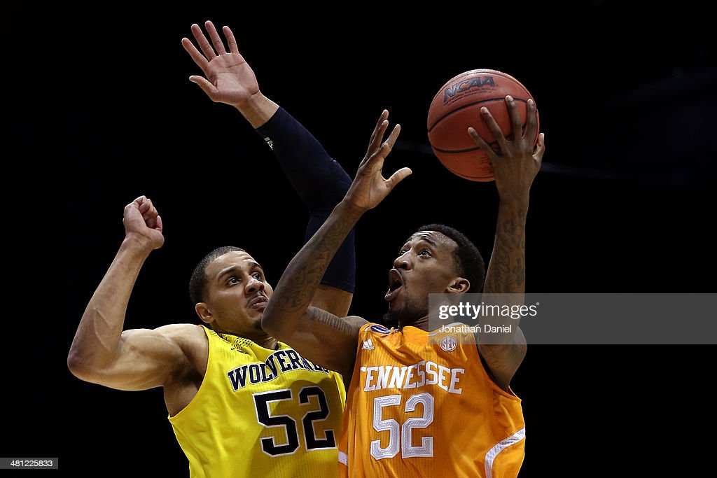Jordan McRae of the Tennessee Volunteers shoots the ball against Jordan Morgan of the Michigan Wolverines during the regional semifinal of the 2014...