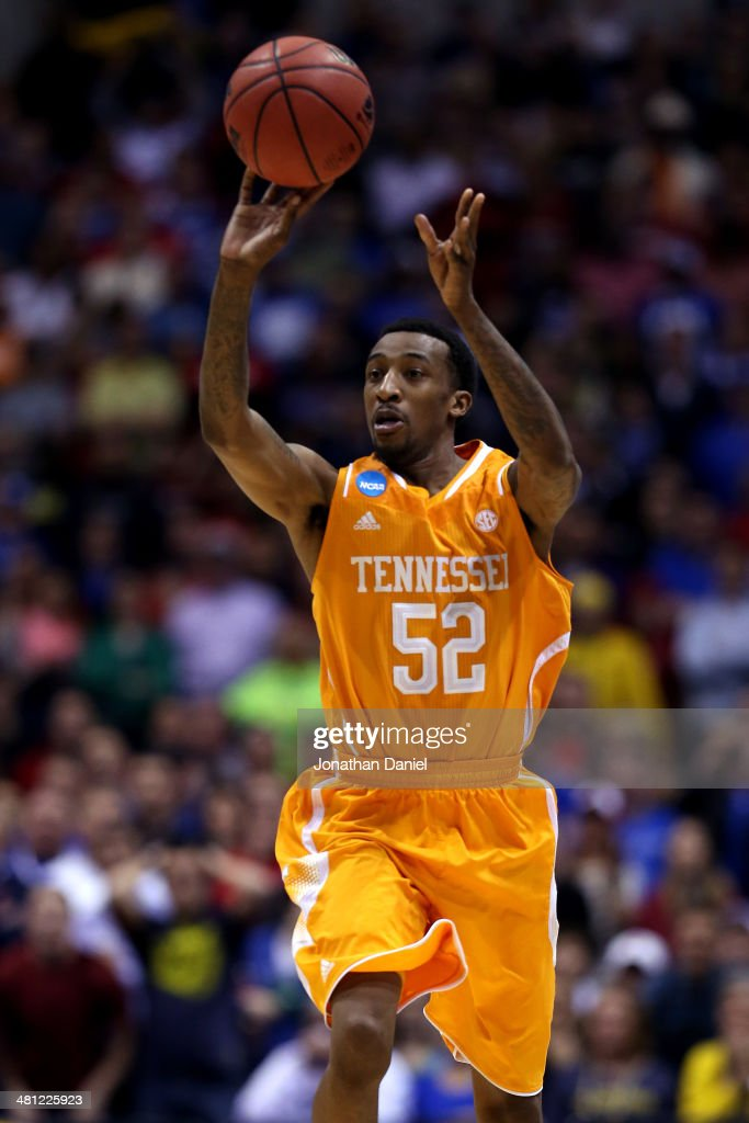 <a gi-track='captionPersonalityLinkClicked' href=/galleries/search?phrase=Jordan+McRae&family=editorial&specificpeople=7362664 ng-click='$event.stopPropagation()'>Jordan McRae</a> #52 of the Tennessee Volunteers shoots the ball to miss the final shot to be defeated by the Michigan Wolverines 73 to 71 during the regional semifinal of the 2014 NCAA Men's Basketball Tournament at Lucas Oil Stadium on March 28, 2014 in Indianapolis, Indiana.