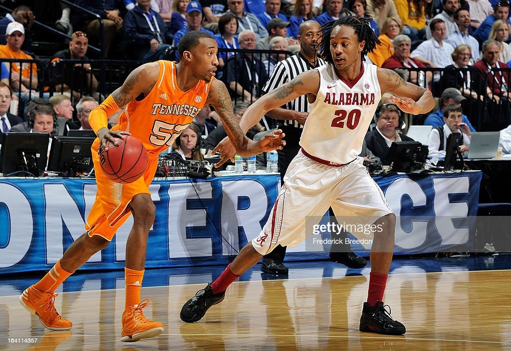 Jordan McRae #52 of the University of Tennessee Volunteers plays against Levi Randolph #20 the Alabama Crimson Tide during the Quarterfinals of the SEC Tournament at the Bridgestone Arena on March 15, 2013 in Nashville, Tennessee.