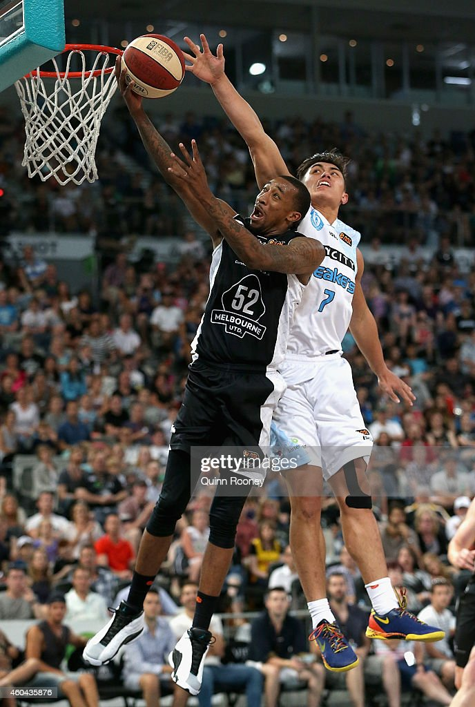 Jordan McRae of United shoots whilst Reuben Te Rangi of the Breakers attempts to block during the round 10 NBL match between Melbourne United and the...