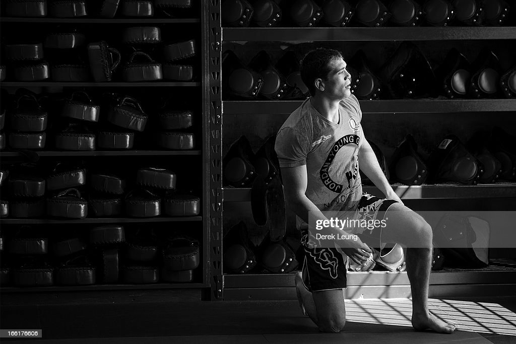 Jordan Mein takes a moment before a public training session on April 9, 2013 at Champion's Creed Gym in Calgary, Alberta, Canada.